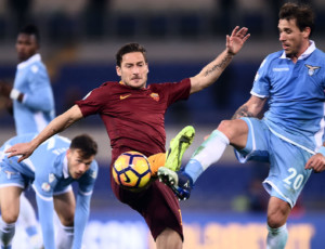 Roma's forward from Italy Francesco Totti (C) vies with Lazio's midfielder from Argentina Lucas Biglia during the Italian TIM Cup 1st leg semifinal football match on March 1, 2017 at the Olympic stadium in Rome.  / AFP PHOTO / FILIPPO MONTEFORTE        (Photo credit should read FILIPPO MONTEFORTE/AFP/Getty Images)