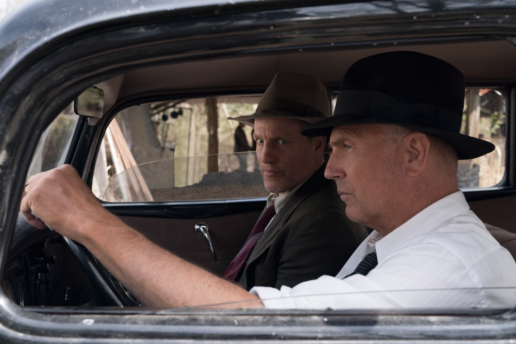 "pictured L-R: Woody Harrleson (""Maney Gault"") and Kevin Costner (""Frank Hamer"") in THE HIGHWAYMEN"